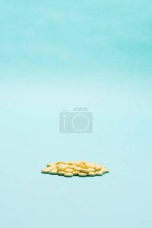 Medicine. Yellow pills on blue background.