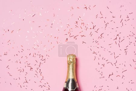 Photo for Flat lay of Celebration, Champagne bottle with colorful party streamers on pink background - Royalty Free Image
