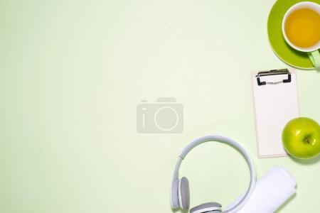 Headphone, tea, apple and headphone