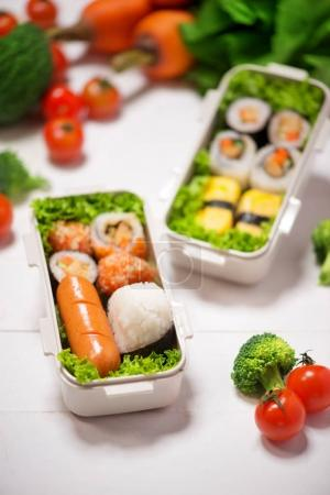 Bento boxes with different food