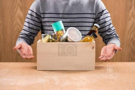 volunteer holding box with foodstuffs