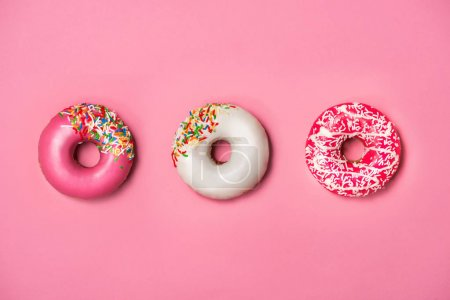 Three donuts with icing