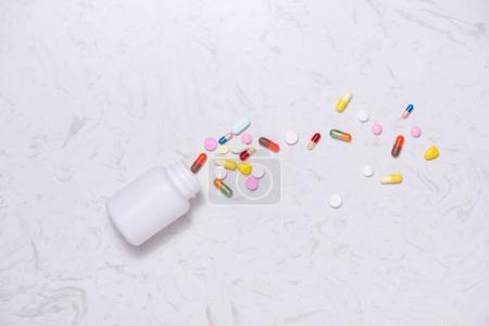 Colored pills with bottle
