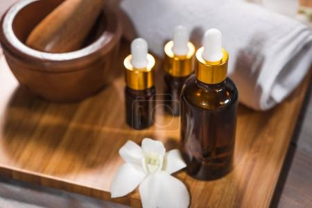 towel, white orchid and bath oil