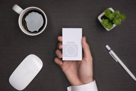 Mockup of white business cards in male hand