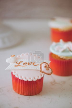 Valentine sweet love cupcakes on table on light background, close up