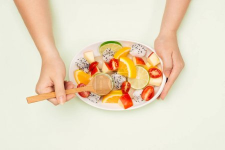 Top view of a man enjoying delicious summer fruits