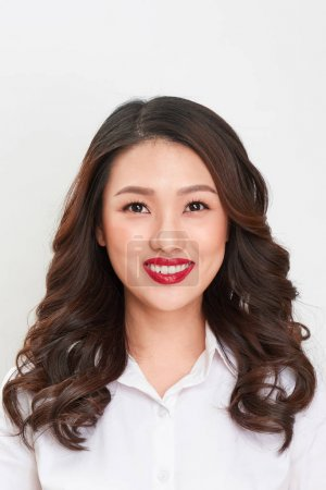 Photo for Passport photo. Portrait of asian smiling woman. - Royalty Free Image