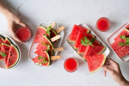 Delicious watermelon summertime snack on plate. Dessert. Flat lay, top view.