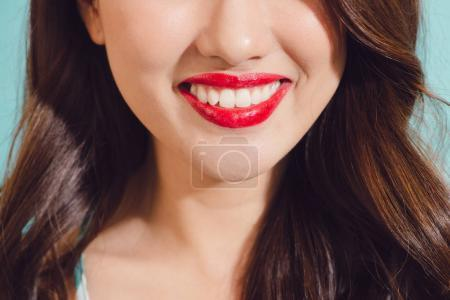 Closeup of lovely red lips smile of young asian woman