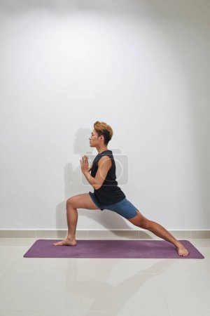 Fitness man doing workout indoors