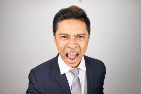 Photo for Angry businessman shouting isolated in a white background - Royalty Free Image
