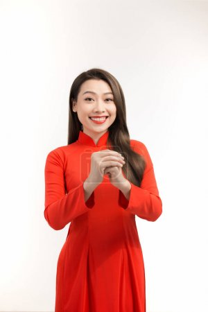Photo for Beauty woman wear aodai and smile to you in chinese new year - Royalty Free Image