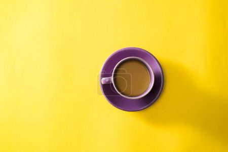 Photo for Purple cup of coffee on the yellow background - Royalty Free Image