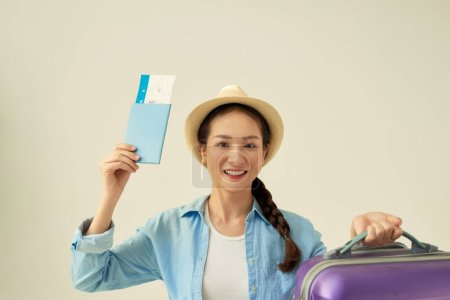 Photo for Business woman traveling holding passport, ticket and bag - isolated - Royalty Free Image