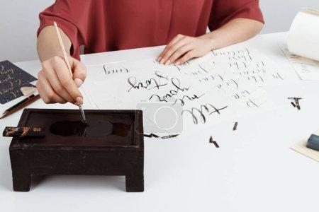 Girl writing calligraphy on postcards. Art design.
