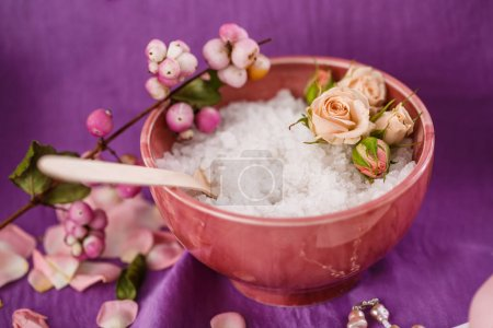 Spa massage. Aromatherapy. Salt body scrub on purple issue