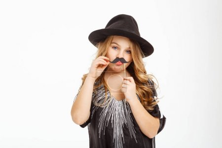 Long haired blonde posing with moustache mask on a stick.