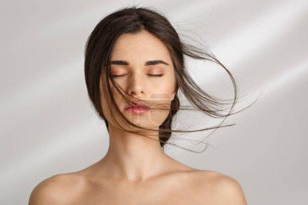 Woman after spa procedures enjoying herself