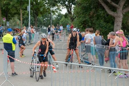 Regensburg, Bavaria, Germany, August 06, 2017, 28th Regensburg Triathlon 2017, Downswing of a bike racer in the transition area