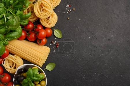 Photo for Pasta, vegetables, herbs and spices for Italian food on black background, top view, copy space - Royalty Free Image