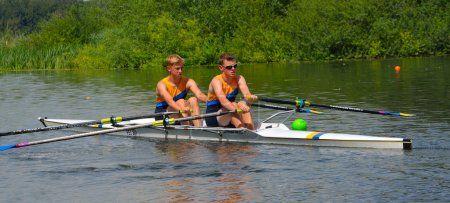 Young men in Pairs Sculling on the river Ouse at St Neots.