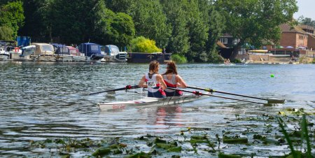 Young women in Pairs Sculling on the river Ouse at St Neots.