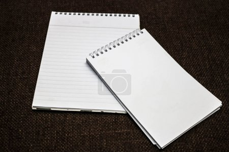 Two blank notepads