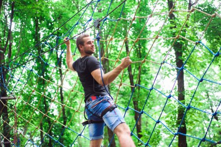Hiking in the rope park beautiful sports guy