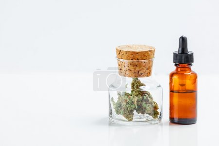 Medical Marijuana In Glass Jar Cannabis Oil Extract In Bottle Is