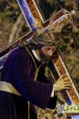 Nazarene of the brotherhood of the or in the holy week in Seville