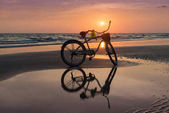 Sun set time with the bicycle on the beach