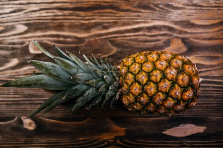 Ripe fresh pineapple  on wooden table...
