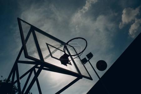 Basketball and ball silhouette