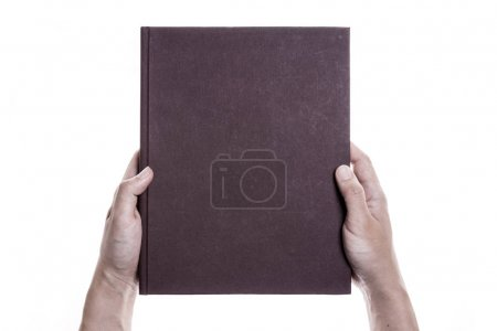 Photo for A man hand hold a empty(blank) book cover isolated white. - Royalty Free Image