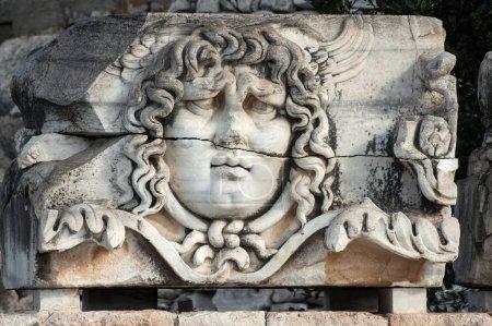 Medusa head in ancient Temple of Apollo in Didim, ...