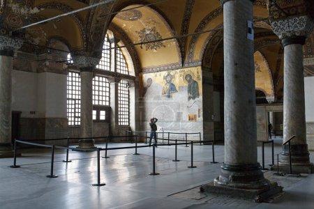 Photogapher shoting 13th century Deesis Mosaic
