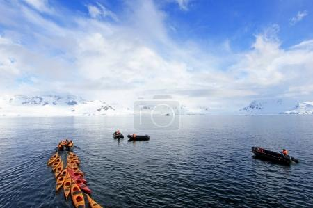 Beautiful colourful kayaks on the blue ocean, Antarctic Peninsula