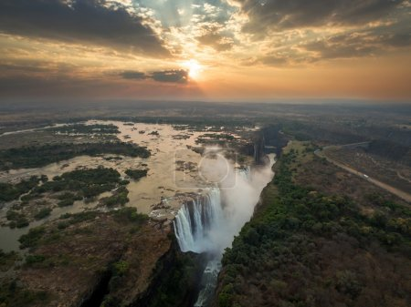 Victoria waterfall in Zimbabwe in morning light, a...