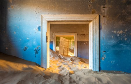 Abandoned building with sand in Namib desert