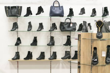 Shelves with leather shoes in a shoe store...
