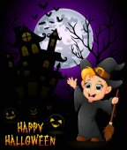 Little boy in a witch costume with pumpkin and haunted house