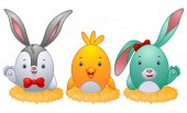 Funny easter eggs with rabbit ears in the nest