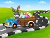 Easter Bunny driving a car carrying easter eggs on road