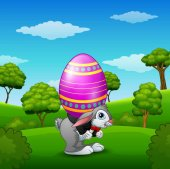 Cartoon easter bunny carrying easter eggs in the park