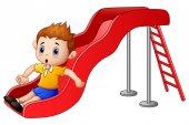 Little boy cartoon playing on a slide