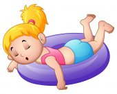 Little girl sleeping above an inflatable ring