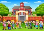 Happy school children in outside the front of school building