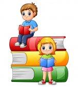 Happy school children with big books