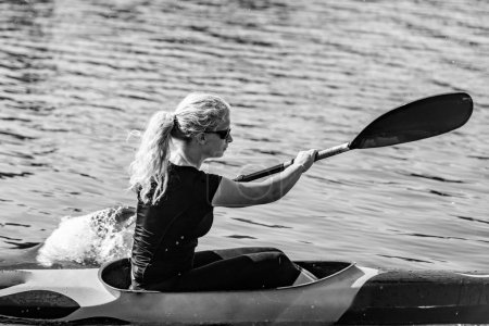 Female Kayaker training on lake